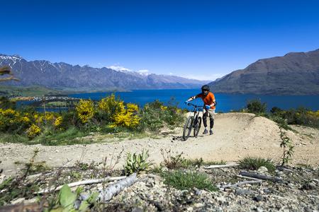 adrenalin: Mountain bike rider on bike path in Queenstown, New Zealand