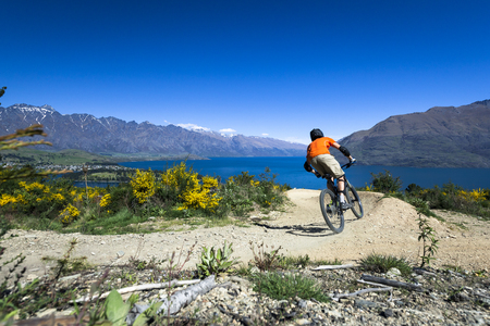 Mountain bike rider on bike path in Queenstown, New Zealand