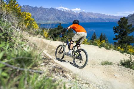 new path: Mountain bike rider on bike path in Queenstown, New Zealand
