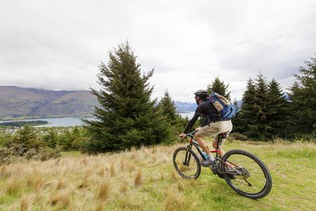 mountain biker: Mountain bike rider at Lake Wanaka, New Zealand Stock Photo