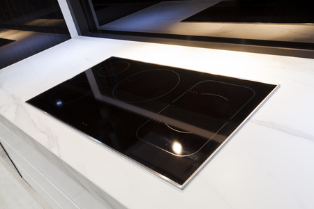 cooktop: Modern induction cooktop in modern kitchen