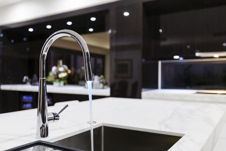 faucet water: Modern kitchen faucet with LED light Stock Photo