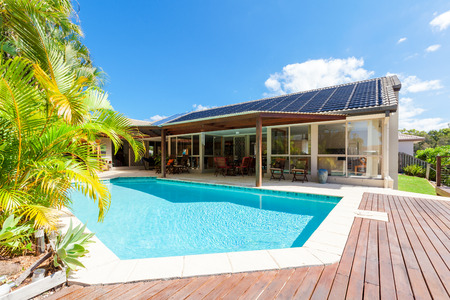 Backyard with swimming pool in stylish home Stok Fotoğraf