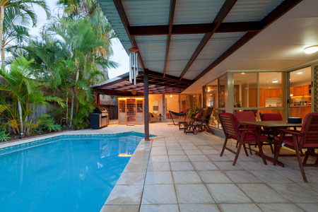 Backyard with swimming pool in stylish home Reklamní fotografie