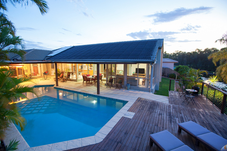 Backyard with swimming pool in stylish home Stock fotó
