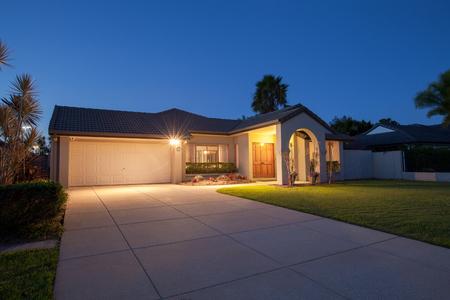 Suburban australian house front at dusk Stock Photo