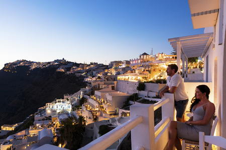 island: Romantic couple at sunset in Santorini Stock Photo