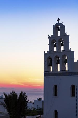 Sunset behind Santorini church, Greece