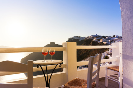 island: Sunset drinks in Santorini, Greece Stock Photo