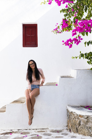 Attractive girl in colourful Greek Island setting