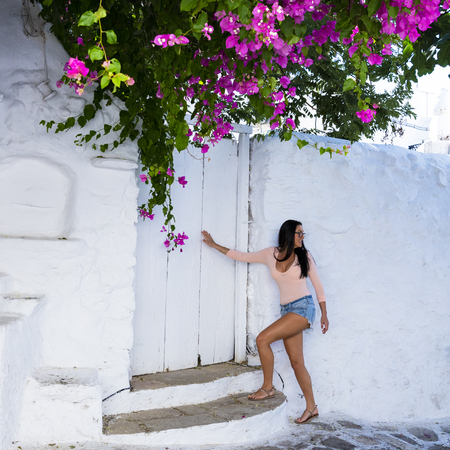 traditional: Attractive girl in colourful Greek Island setting