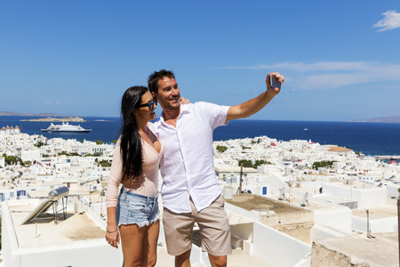 Young couple taking selfie in Mykonos, Greece