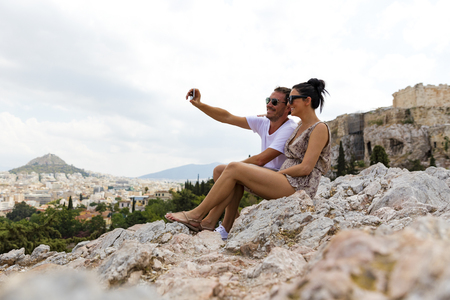 Young couple taking selfie at the Acropolis in Greece