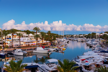 island: Cala DOr marina precinct at sunset, Mallorca, Spain