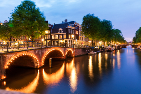 Traditional Amsterdam buildings and canals at dusk Stock Photo