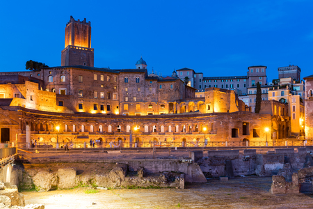 Ancient Ruins of Imperial Forum at dusk in Rome, Italy