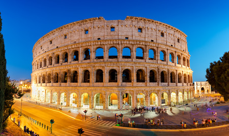 europe: Panoramic night view of the Colosseum amphitheatre in the centre of Rome