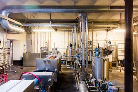 Professional microbrewery set up with stainless steel drums and pipes Lizenzfreie Bilder