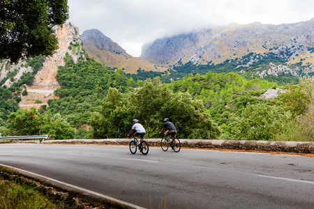 Cyclists riding up the Puig Major peak in Majorca, Spain