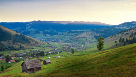 View of traditional Transylvanian valley at sunset, Romania