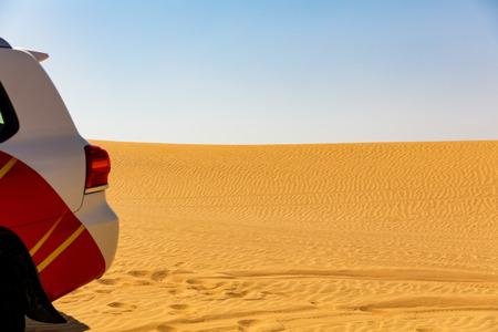 Off road vehicle in desert sand dunes, UAE