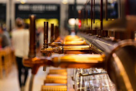 Close up of vintage beer taps inside restaurant Stock Photo