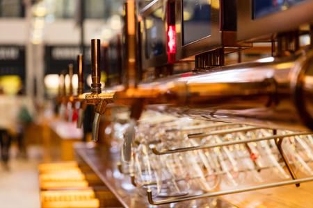 Close up of vintage beer taps inside restaurant Lizenzfreie Bilder