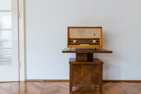 Vintage radio on old cabinet in stylish old home