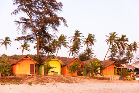 Arambol beach cabins at sunset, Goa, India