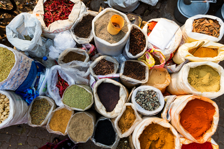 Indian spices on street market stall, top shot