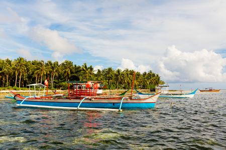 Tropical Siargao island with traditional fishing boats in the Philippines