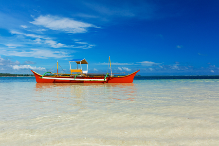 Traditional fishing boat on pristine beach, Siargao, Philippines