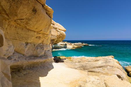 Rocky blue beach on the east coast of Valletta, Malta Stock Photo