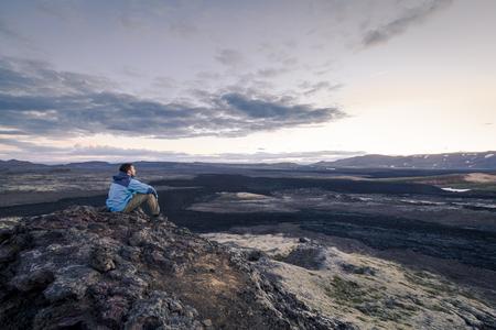 Tourist overlooking the smouldering Krafla Lava Fields