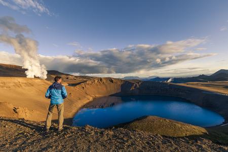 Explorer overlooking Viti crater near Krafla lava fields, Iceland