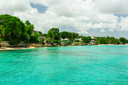 The sunny tropical Caribbean island of Barbados with  blue water and yachts