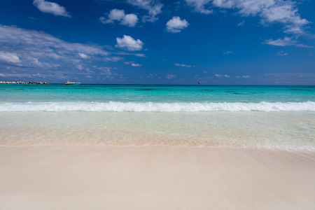 Pristine white sandy beach and turquoise coloured sea in Cancun, Mexico
