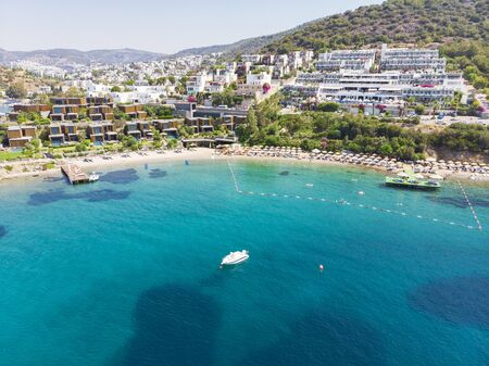 Aerial view of sunny Bodrum with resorts and beachfront villas, Turkey