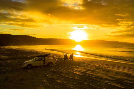 People enjoying the sunset on Rainbow beach, QLD, Australia