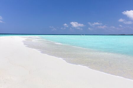 Hammock on amazing white sand bar in pristine tropical waters on a sunny day