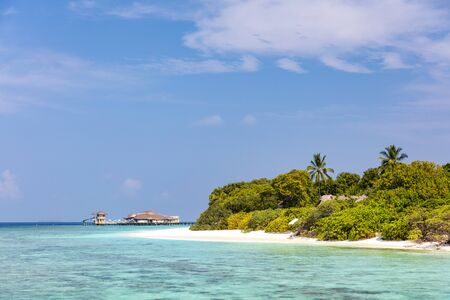 Secluded private beach on pristine tropical island on sunny day