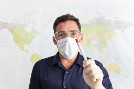 Doctor with a nasal swab used to test for possible coronavirus infection