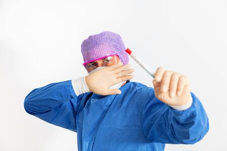 Doctor in a protective suit holding a nasal swab used to test for possible coronavirus infection Standard-Bild