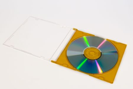 compact disk: A blank compact disk in a yellow box isolated on a white background.