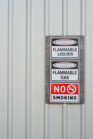 Danger and No smoking labelssigns on a tin wall photo