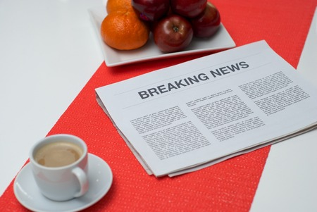 breaking news: Breaking news article in the newspaper at home.