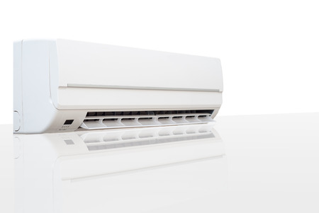 White air conditioner with reflection on a glossy surface photo