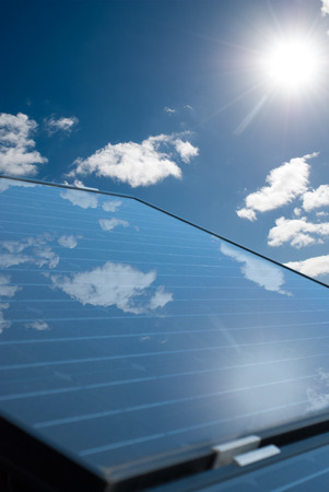 producing: Solar panels producing electricity on a sunny day