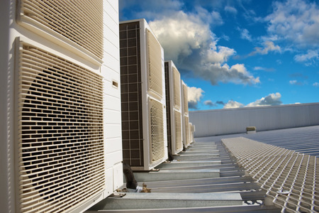 cooling system: HVAC units on a metal industrial roof in the afternoon