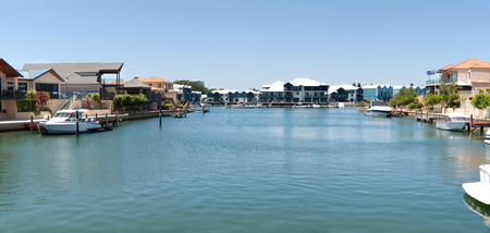 Luxury houses and boats on the canals in Mandurah, Western Australia.